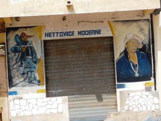 07 Nov 2008<br>Yeumbeul, Dakar. <br> Shop fronts. Definition of &quot;modern&quot; please? by Google Translate
