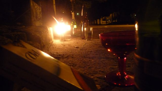 16 Feb 2009<br>In the evening, often, I am warned by these little lights that shine in the street. These are a few offerings to deities or local saints. Cigarettes, alcohol, fruit, it is good to be God in the corner! <br> Niteroi, Rio de Janeiro, Brazil