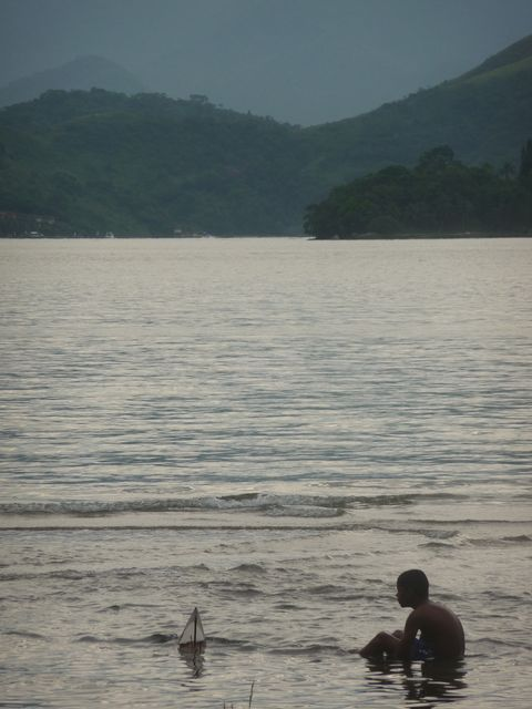 27 Feb 2009<br>Evening camp on the shore of the bay bucolic. Water is also a good hot bath. A child plays. <br> Angro dos Reis, Rio de Janeiro, Brazil