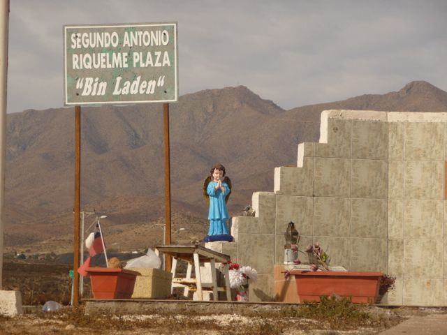 04 Jul 2009<br>On the road, small places of worship mark the path. Sometimes a funny name and news comes out! <br> Atacama Desert, Chile