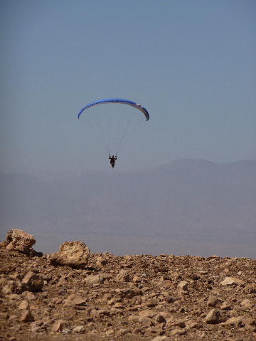 Aguergour, South Marrakech, paragliding site. <br> Nouredine in flight.