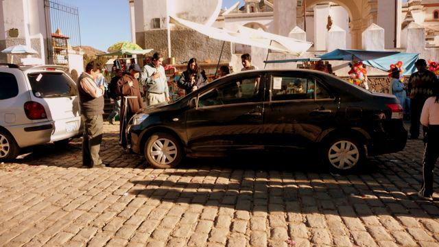 03 Oct 2009<br>Arriving on Copacabana, with a surprising attention stops. A priest in basketball cap on his head and blessed the cars! The religious trinkets are plentiful in this part of monde.Copacabana, Bolivia