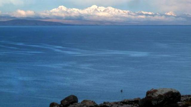 05 Oct 2009<br>Lake Titicaca is the highest navigable lake in the world. The deep blue sky above sea level is reflected beautifully in its clear water and cold as death. The mountains in the background keep a few precious minutes of light soir.Isla del Sol, Bolivia