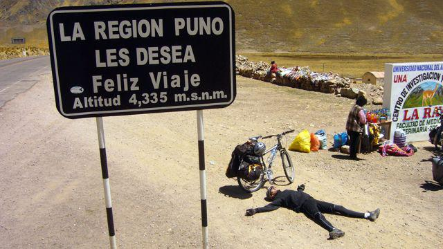 15 Oct 2009<br>Poor Seb! Just arrived, we put on the bike for three successive stages of one hundred kilometers daily to more than 3500m above sea level. Here he is on top of the pass at 4335m above sea level, completely dead! South Route Cusco, Peru