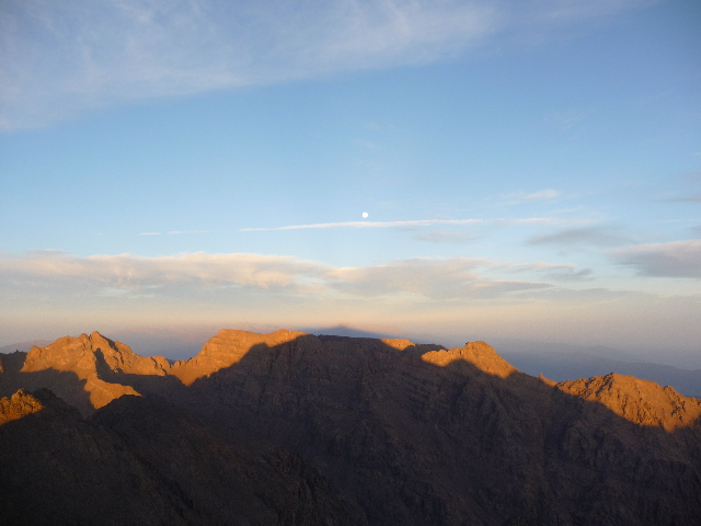 16 Sep 2008<br>Summit of Mount Toubkal, 4167m, High AtlasLever sun above. The shadow cone of the mountain draws a triangle on the horizon.