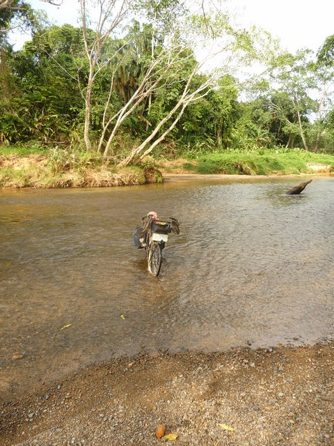 Crossing a river by wading into the Darien to San Blas between Carter and Panama City. <br> Carti, Panama