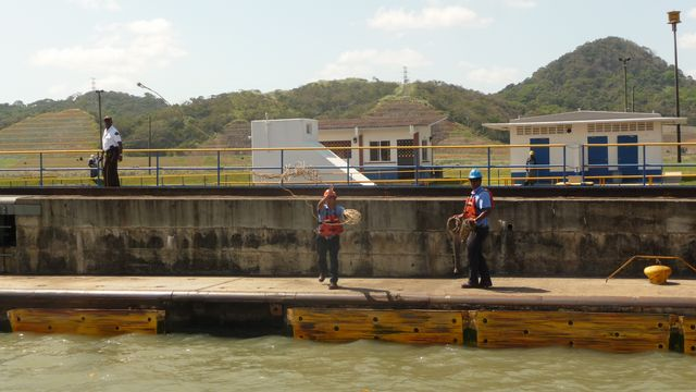 The 'Line Handlers' (lines contents) are listed next to the canal and boat. Those lines sending side channel to the ship (us) with the end of 'monkey fists' hard little balls of string ready to stun the bewildered that does not lend attention.Canal of Panama, Panama