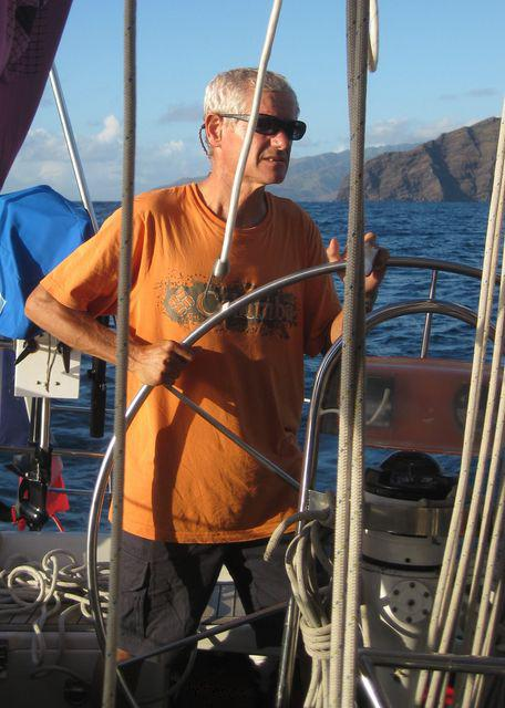 04 May 2010<br>Fred, our captain at the helm to negotiate the entrance to the anchorage Iva Oa Marquises.Voilier Tago Mago, Pacific Crossing between Galapagos and the Marquesas